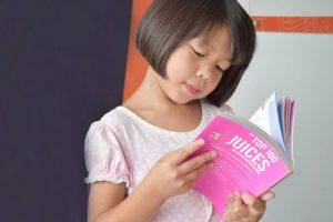 Pediatric eye care Laguna Beach CA -Asian Girl Reading Book